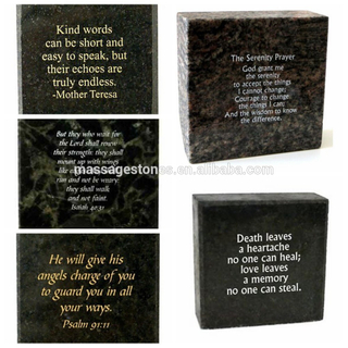 Engraved black block stone in granite with Quotes